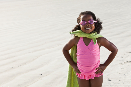 Girl superhero on the beach