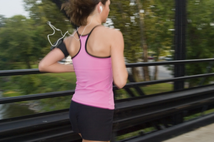 Girl Jogging on a bridge